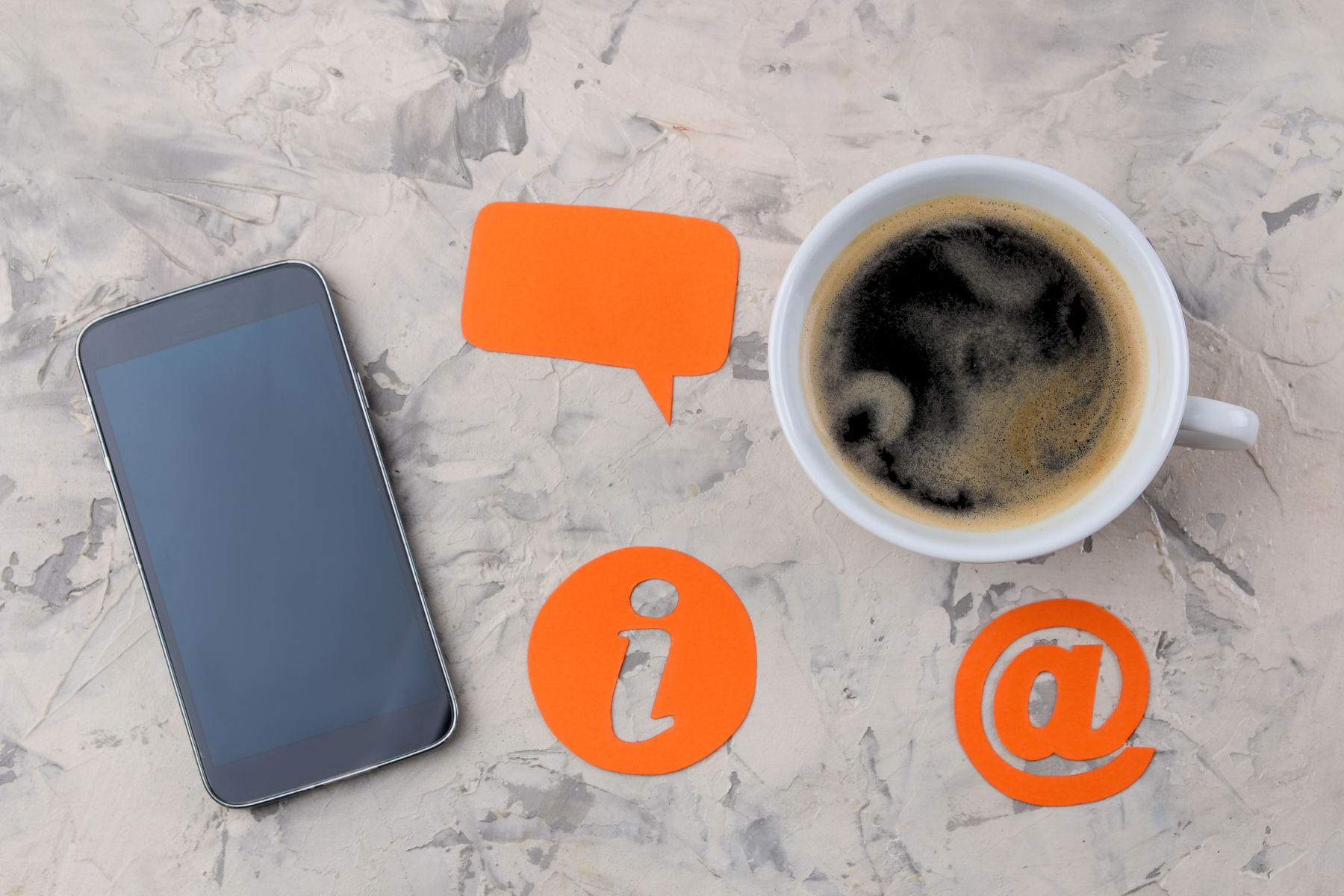 client support service. Contact us for feedback. desktop with a cup of coffee and a smartphone and various feedback icons.